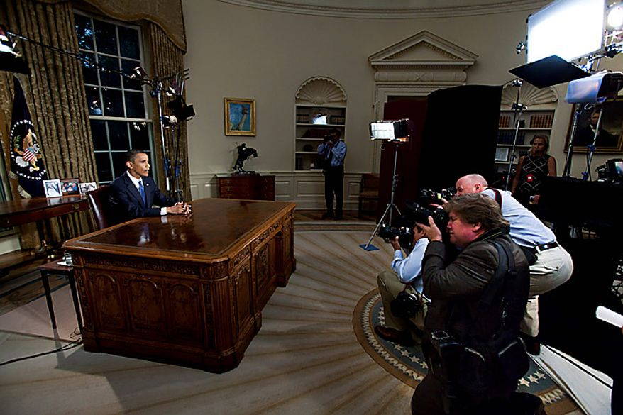 """President Obama speaks during a nationally televised address from the Oval Office at the White House in Washington on Tuesday, June 15, 2010. Mr. Obama said the oil spill in the Gulf of Mexico is an urgent call for action to cut U.S. dependence on fossil fuels and vowed that BP PLC will be required to spend whatever is needed to repair damage caused by the company's """"recklessness."""" (Bloomberg News/Jim Lo Scalzo/Pool)"""