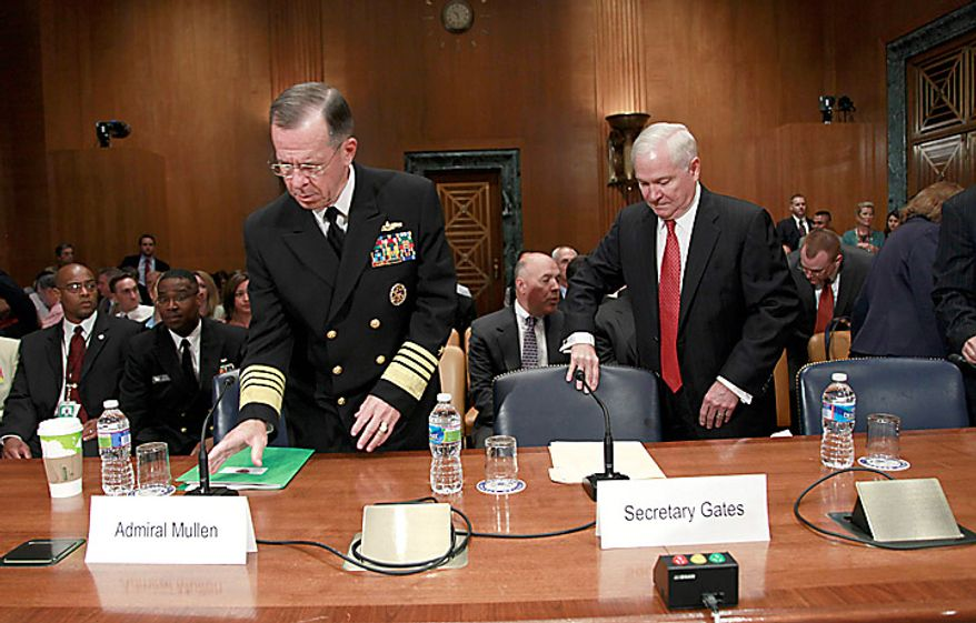 Joint Chiefs Chairman Adm. Mike Mullen, left, and Defense Secretary Robert Gates, take their seats on Capitol Hill in Washington, Wednesday, June 16, 2010, prior to testifying before the Senate Appropriations Committee hearing on the Defense Department's fiscal 2011 budget. (AP Photo/Pablo Martinez Monsivais)