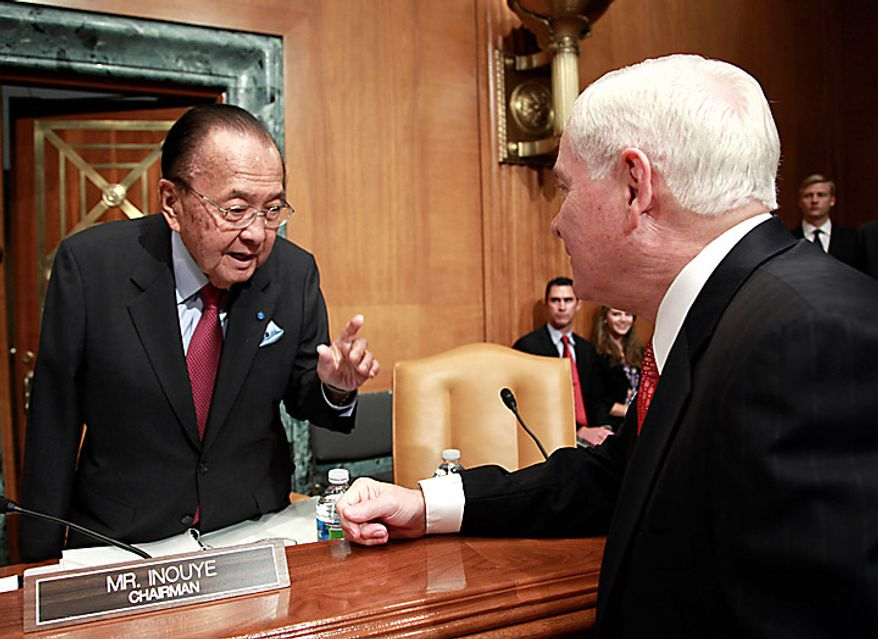 Senate Committee Appropriations Chairman Sen. Daniel Inouye, D-Hawaii, left, talks with Defense Secretary Robert Gates, on Capitol Hill in Washington, Wednesday, June 16, 2010, before the start of the committee's hearing on the Defense Department's fiscal 2011 budget. (AP Photo/Pablo Martinez Monsivais)