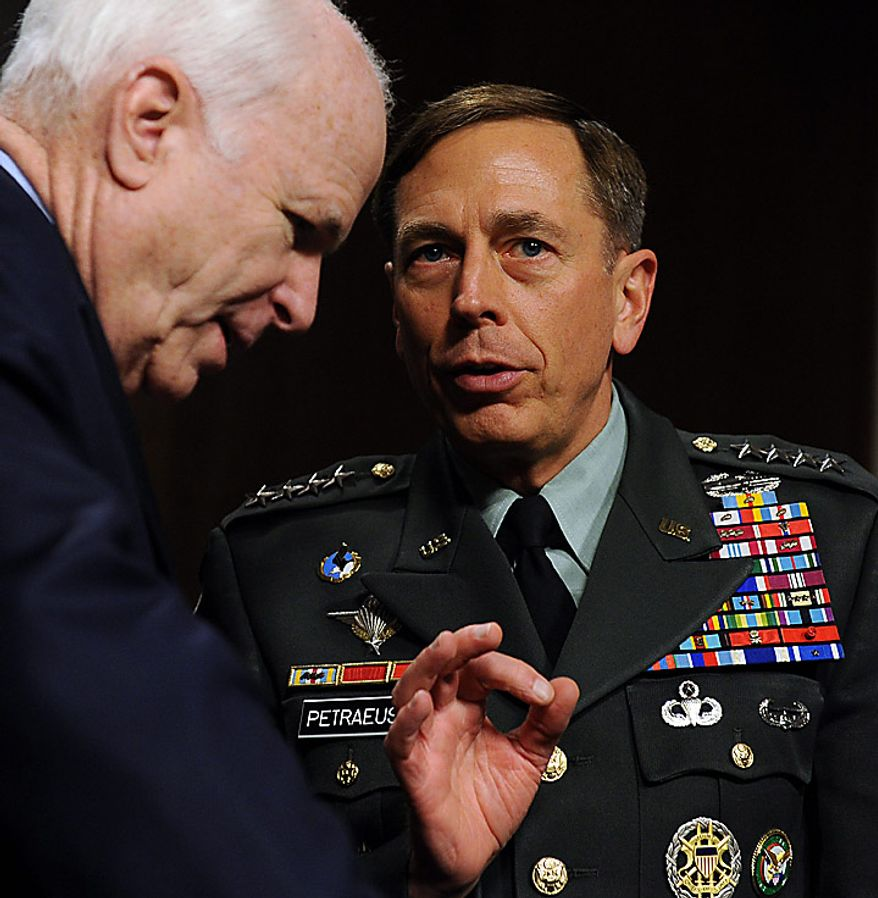 Army General David H. Petraeus, commander, U.S. Central Command, speaks with Sen. John McCain, Arizona Republican, prior to testifying before the Senate Armed Services Committee on the situation in Afghanistan on Capitol Hill in Washington on June 16, 2010. The hearing is continued from Tuesday when Gen. Petraeus slumped briefly during testimony, which aides blamed on dehydration and jet lag. (UPI/Roger L. Wollenberg)