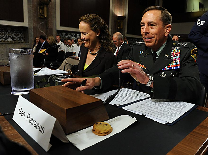 Army Gen. David H. Petraeus, commander, U.S. Central Command, prepares to testify before the Senate Armed Services Committee on the situation in Afghanistan on Capitol Hill in Washington on June 16, 2010. The committee gave him a few cookies after the hearing was continued from Tuesday when Gen. Petraeus slumped briefly during testimony, which aides blamed on dehydration and jet lag. At left is Michele Flournoy, undersecretary of defense for policy. (UPI/Roger L. Wollenberg)