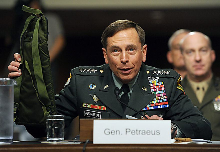 """Army Gen. David H. Petraeus, commander, U.S. Central Command, holds up a water container called a """"camelback"""" as he testifies before the Senate Armed Services Committee on the situation in Afghanistan on Capitol Hill in Washington on June 16, 2010. The hearing is continued from Tuesday when Gen. Petraeus slumped briefly during testimony, which aides blamed on dehydration and jet lag. (UPI/Roger L. Wollenberg)"""