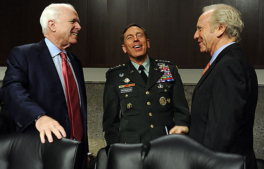 Army Gen. David H. Petraeus, commander, U.S. Central Command, talks with Sen. John McCain, Arizona Republican (left) and Sen. Joseph I. Lieberman, Connecticut Independent, (right) prior to testifying before the Senate Armed Services Committee on the situation in Afghanistan on Capitol Hill in Washington on June 16, 2010. The hearing is continued from Tuesday when Gen. Petraeus slumped briefly during testimony, which aides blamed on dehydration and jet lag. (UPI/Roger L. Wollenberg)