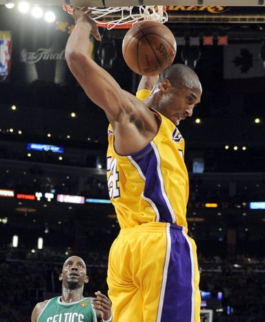 Los Angeles Lakers guard Kobe Bryant dunks during the second half of Game 1 of the NBA basketball finals against the Boston Celtics on Thursday, June 3, 2010, in Los Angeles. (AP Photo/Mark J. Terrill, Pool)