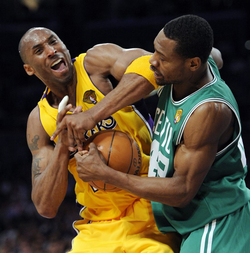 Los Angeles Lakers guard Kobe Bryant struggles for the ball with Boston Celtics guard Tony Allen during the second half of Game 6 of the NBA basketball finals on Tuesday, June 15, 2010, in Los Angeles. The Lakers won 89-67. (AP Photo/Mark J. Terrill)