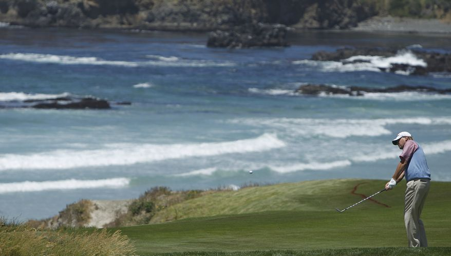 Steve Stricker hits up to the 10th hole during a practice round for the U.S. Open golf tournament Wednesday, June 16, 2010, at the Pebble Beach Golf Links in Pebble Beach, Calif. (AP Photo/Matt Slocum)