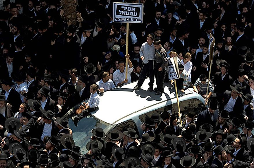Ultra-Orthodox Jewish men demonstrate in Bnei Brak, Israel, on Thursday, June 17, 2010, to protest an Israeli Supreme Court ruling forcing the integration of a religious girls school. (AP Photo/Ariel Schalit)