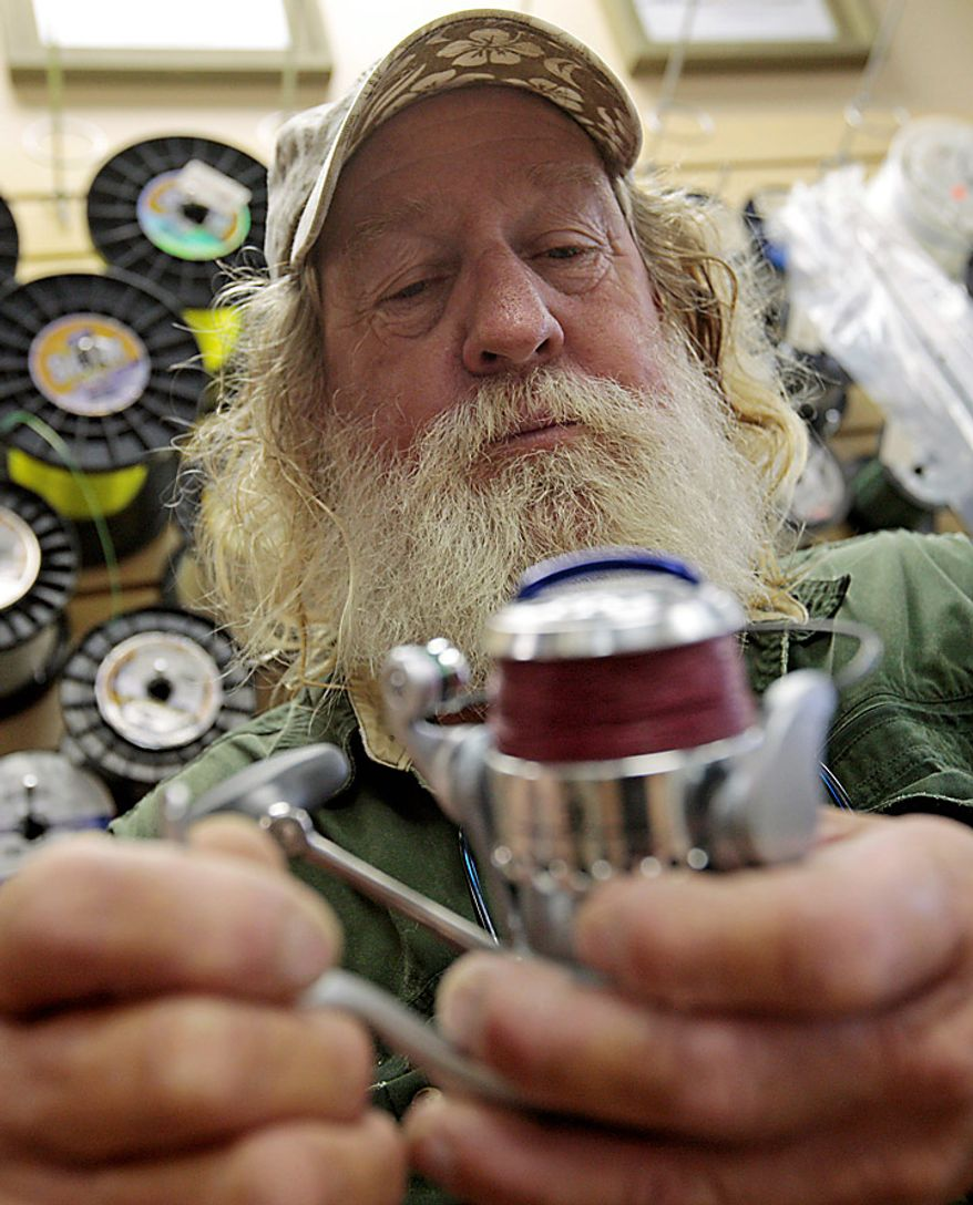 "Boat captain Brent ""Hollywood"" Shaver works on a reel at his son's bait shop Thursday, June 10, 2010.  Shaver, a long time charter boat operator, is shutting down his inshore fishing business because of the gulf oil spill. (AP Photo/Dave Martin)"