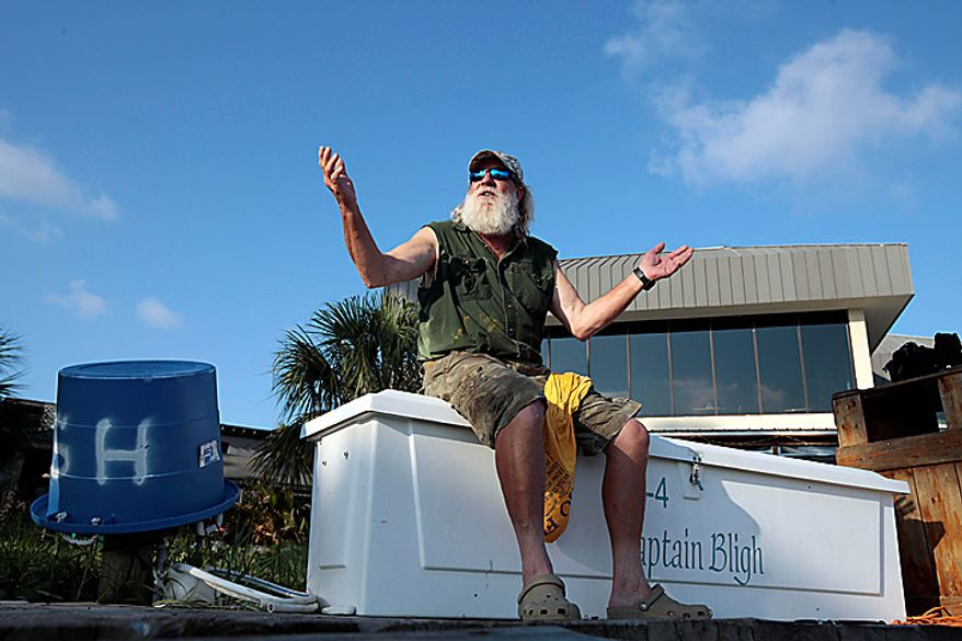 """Boat captain Brent """"Hollywood"""" Shaver sits on the dock at Cotton Bayou in Orange Beach, Ala., Thursday, June 10, 2010.  Shaver, a long time charter boat operator, is shutting down his inshore fishing business because of the gulf oil spill. (AP Photo/Dave Martin)"""