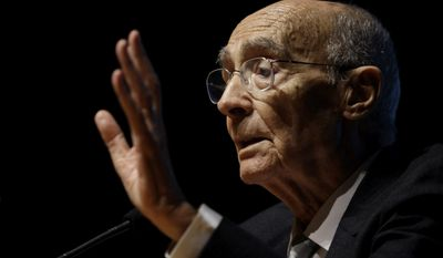 "In this Oct. 30, 2009, file photo, Portuguese writer Jose Saramago, winner of the 1998 Nobel Prize for Literature, gestures during the presentation of his book ""Cain"" in Lisbon. Mr. Saramago died at age 87 on Friday, June 18, 2010, at his home in Lanzarote, one of Spain's Canary Islands. (AP Photo/Armando Franca, File)"