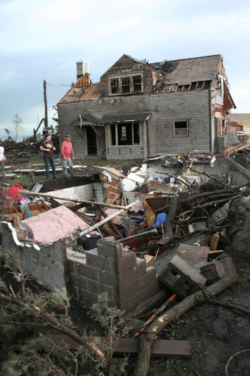 The home of Bob and Laural Hanson is about 50 feet from its foundation, foreground, on Thursday, June 17, 2010 west of Albert Lea, Minn. The couple were not at home when the tornado moved their house. (AP Photo/Tim Engstram/ Albert Lea Tribune)
