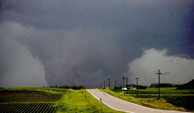 A large funnel cloud touches down west of Albert Lea, Minn., early evening Thursday, June 17, 2010. The tornado was traveling northeast. Several tornadoes were reported in southern Minnesota and northern Iowa Thursday evening, causing three deaths and major property damage. (AP Photo/The Globe-Gazette, Arian Schuessler)