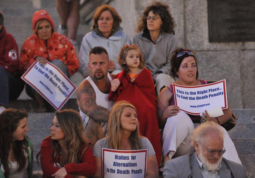 People protest against Ronnie Lee Gardner's death penalty at the Utahns for Alternatives to the Death Penalty rally at the Utah State Capital in Salt Lake City, Utah, Thursday, June 17, 2010. (AP Photo/Deseret News, Matt Gillis)