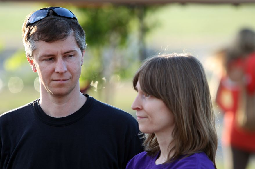 Lynn Taylor, left, and his wife Donna, right, niece of Michael Burdell, who was shot and killed by Ronnie Lee Gardner, speak to the media near the Utah State Prison before the execution of Gardner by firing squad Thursday, June 17, 2010 in Salt Lake City. Gardner, 49, was sentenced to death for a 1985 capital murder conviction stemming from the fatal courthouse shooting of attorney Michael Burdell during an escape attempt. (AP Photo/Steve C. Wilson)