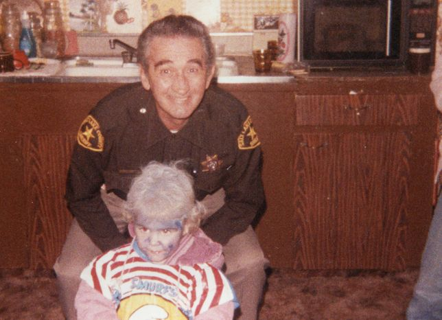 """This October 1984 picture provided by Tami Stewart shows George """"Nick"""" Kirk and his granddaughter Jamie Stewart at Halloween. Kirk was a bailiff who was shot and wounded in Ronnie Lee Gardner's escape attempt in 1985. Kirk suffered chronic health problems until his death in 1995. Gardner was executed by firing squad at midnight on June 18, 2010. (AP Photo/Tami Stewart)"""