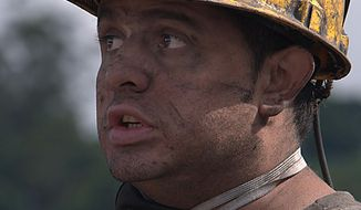 ** FILE ** A unidentified miner from Amaga, Colombia, 2010. (Associated Press)