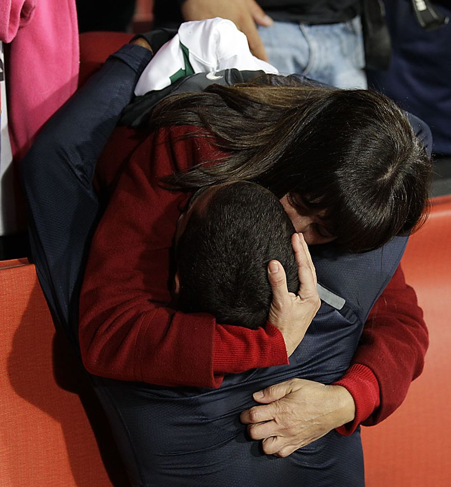 United States' Herculez Gomez is hugged by a fan at the end of the World Cup group C soccer match between Slovenia and the United States at Ellis Park Stadium in Johannesburg, South Africa, Friday, June 18, 2010. The game ended 2-2.  (AP Photo/Luca Bruno)