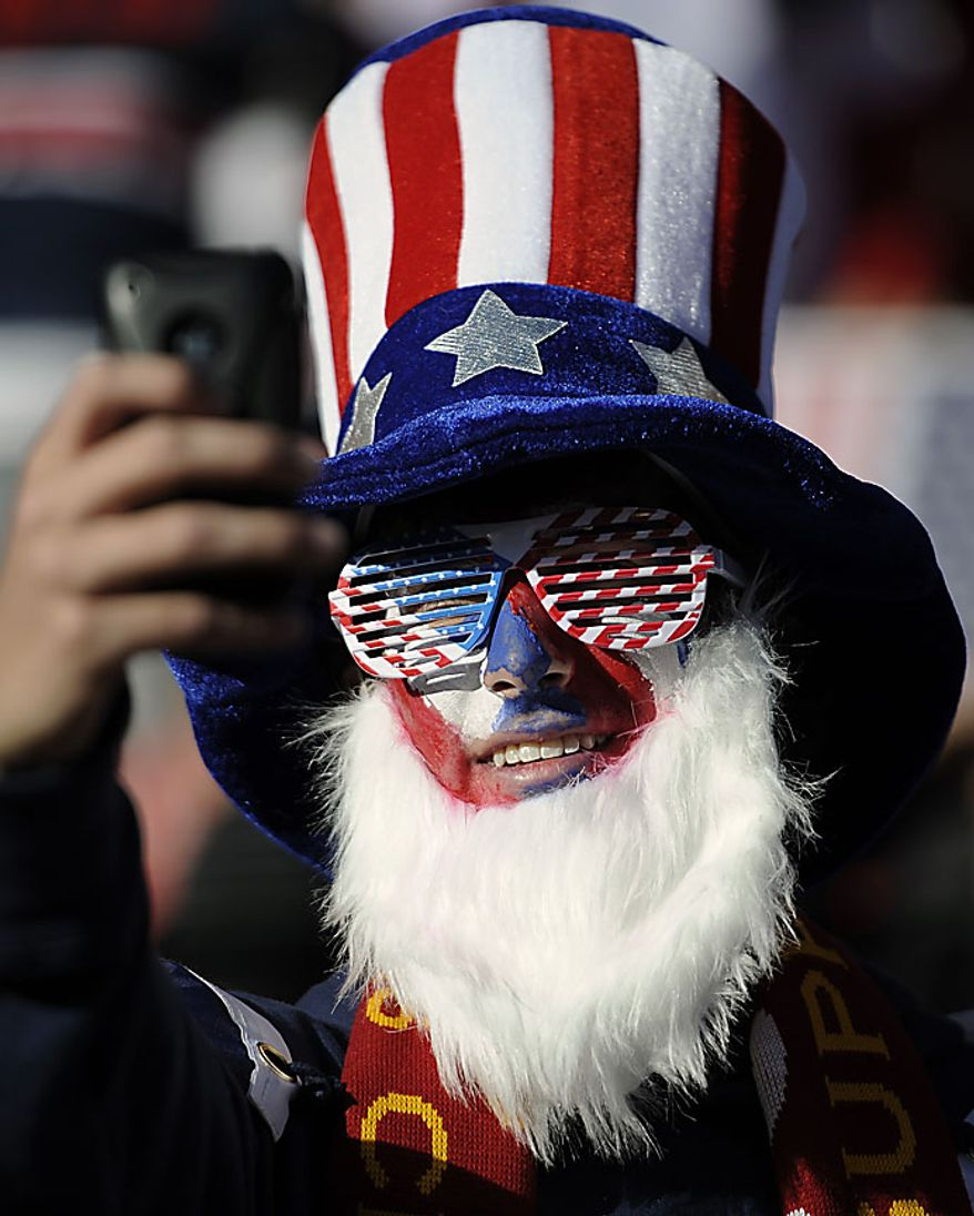 A supporter of the United States poses for a photo before the World Cup group C soccer match between Slovenia and the United States at Ellis Park Stadium in Johannesburg, South Africa, Friday, June 18, 2010.  (AP Photo/Martin Meissner)