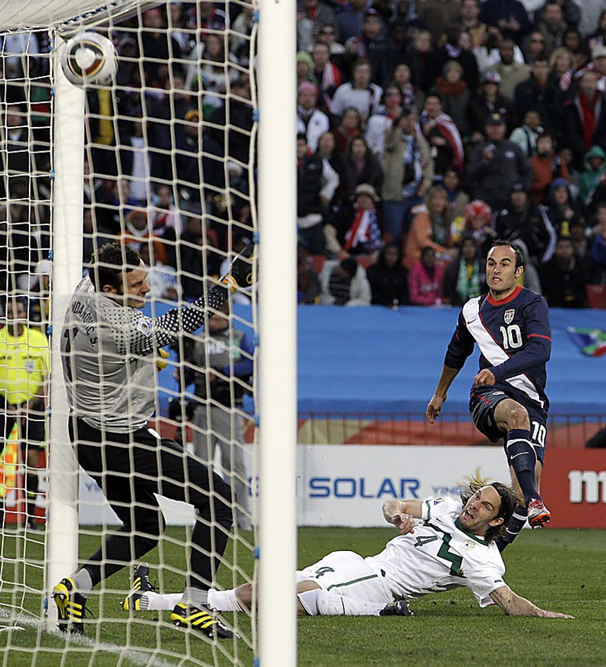 United States' Landon Donovan, top right, scores against Slovenia goalkeeper Samir Handanovic, left, and Slovenia's Marko Suler during the World Cup group C soccer match between Slovenia and the United States at Ellis Park Stadium in Johannesburg, South Africa, Friday, June 18, 2010.  (AP Photo/Elise Amendola)