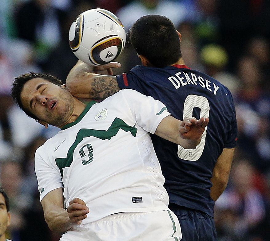 United States' Clint Dempsey, right, and Slovenia's Zlatan Ljubijankic, left, clash as they competes for the ball during the World Cup group C soccer match between Slovenia and the United States at Ellis Park Stadium in Johannesburg, South Africa, Friday, June 18, 2010.  (AP Photo/Elise Amendola)