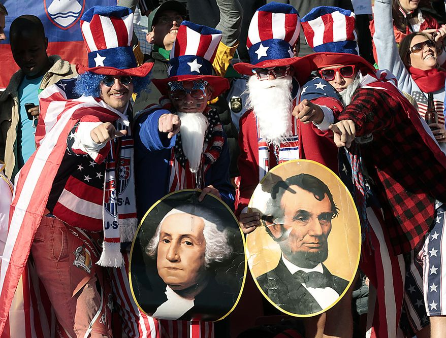 United States' fans cheer holding pictures of George Washington and Abraham Lincoln during the World Cup group C soccer match between Slovenia and the United States at Ellis Park Stadium in Johannesburg, South Africa, Friday, June 18, 2010. (AP Photo/Rob Griffith)