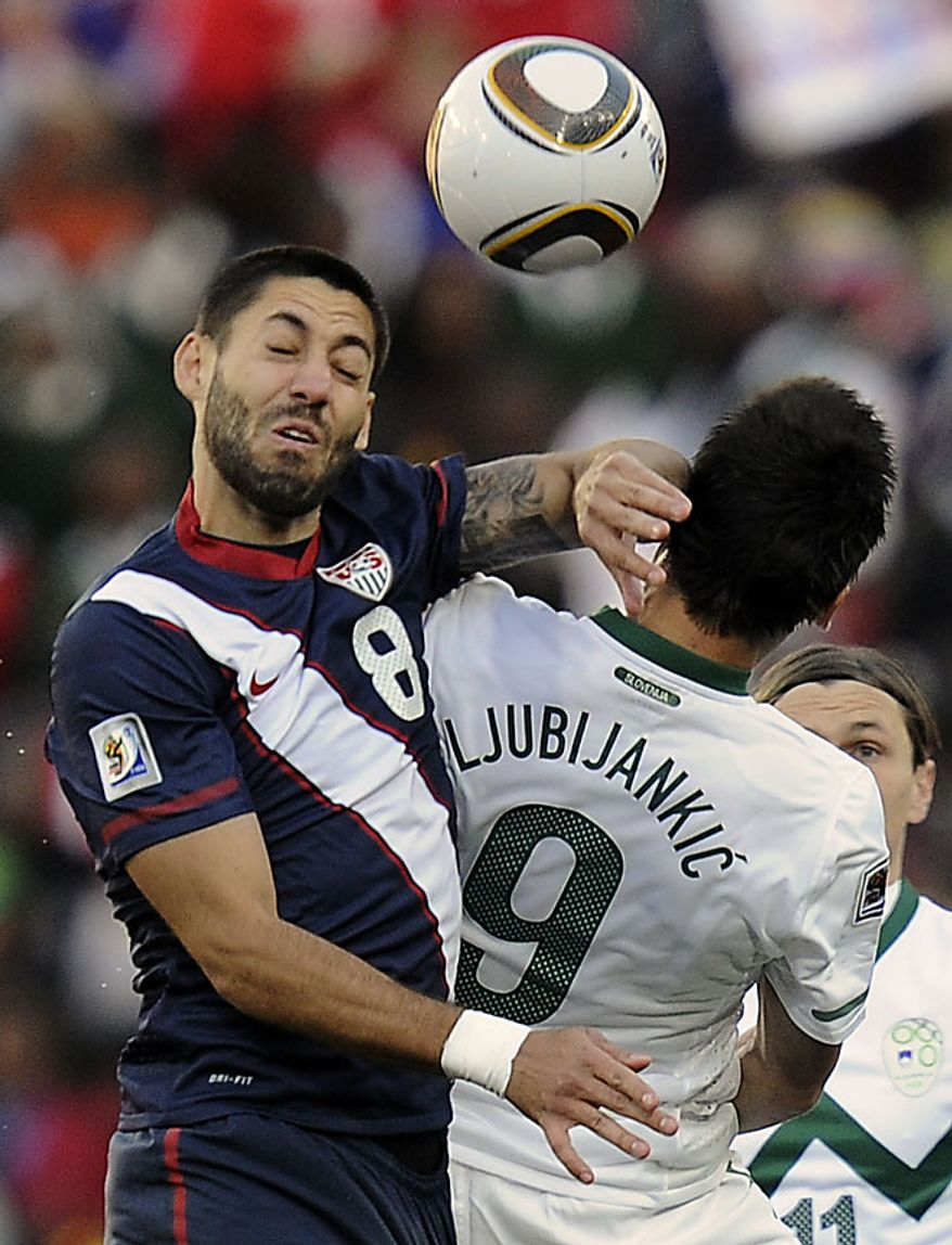 United States' Clint Dempsey, left, and Slovenia's Zlatan Ljubijankic, right, clash as they compete for the ball during the World Cup group C soccer match between Slovenia and the United States at Ellis Park Stadium in Johannesburg, South Africa, Friday, June 18, 2010.  (AP Photo/Martin Meissner)