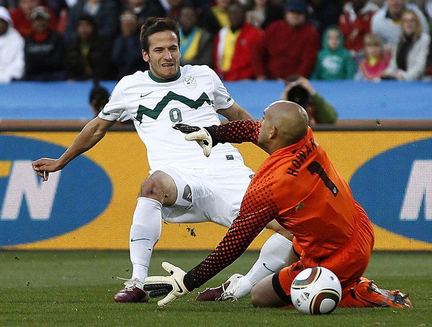 Slovenia's Zlatan Ljubijankic, left, scores a goal against United States goalkeeper Tim Howard during the World Cup group C soccer match between Slovenia and the United States at Ellis Park Stadium in Johannesburg, South Africa, Friday, June 18, 2010.  (AP Photo/Luca Bruno)