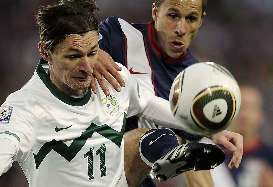 United States' Steve Cherundolo, right, competes for the ball Slovenia's Milivoje Novakovic, left, during the World Cup group C soccer match between Slovenia and the United States at Ellis Park Stadium in Johannesburg, South Africa, Friday, June 18, 2010.  (AP Photo/Martin Meissner)