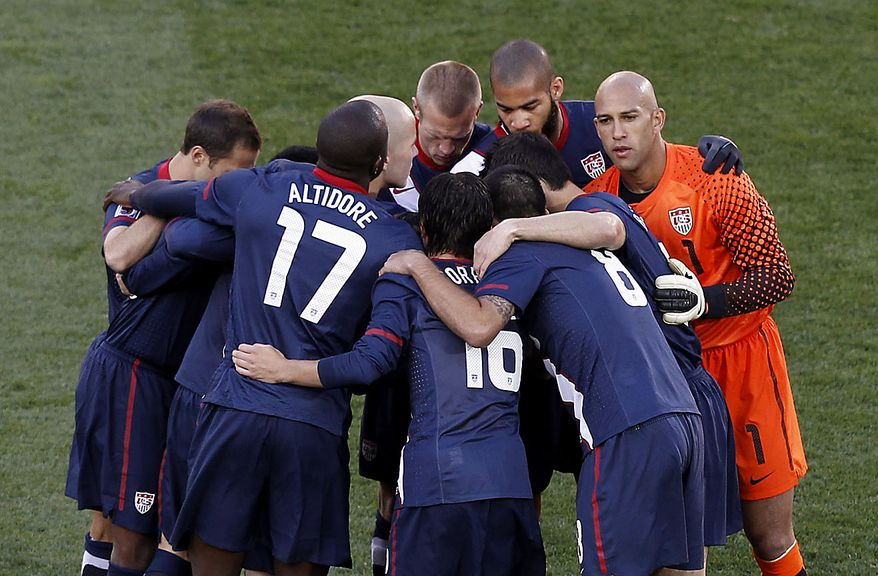 United States team gather prior to the World Cup group C soccer match between Slovenia and the United States at Ellis Park Stadium in Johannesburg, South Africa, Friday, June 18, 2010.  (AP Photo/Hassan Ammar)