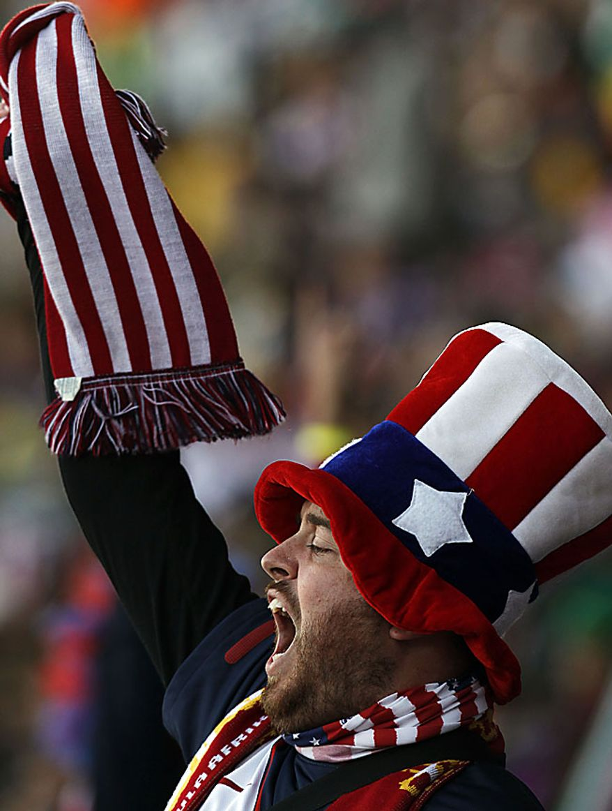 A United States fan cheers during the World Cup group C soccer match between Slovenia and the United States at Ellis Park Stadium in Johannesburg, South Africa, Friday, June 18, 2010.  (AP Photo/Hassan Ammar)