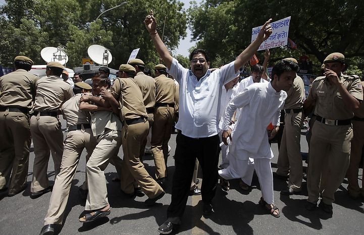 Supporters of India's main opposition Bharatiya Janata Party protest rise in price of essential commodities and fuel in capital New Delhi on Friday, June 18, 2010. (AP Photo/Saurabh Das)