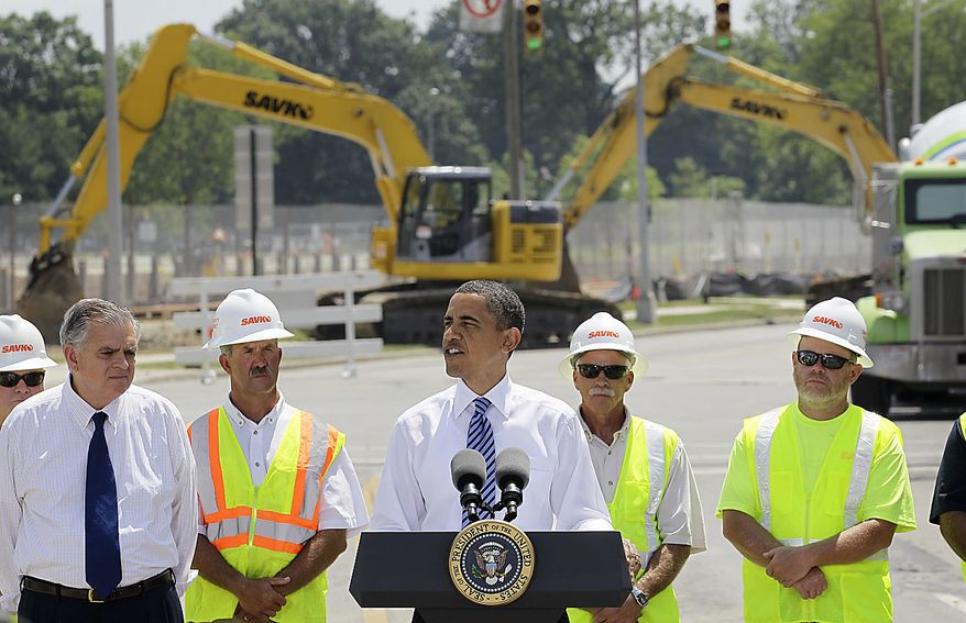 President Obama, accompanied by Transportation Secretary Ray LaHood, left, and others, delivers remarks at the groundbreaking of a road project funded by the American Recovery and Reinvestment Act, Friday, June 18, 2010, in Columbus, Ohio. (AP Photo/Amy Sancetta)