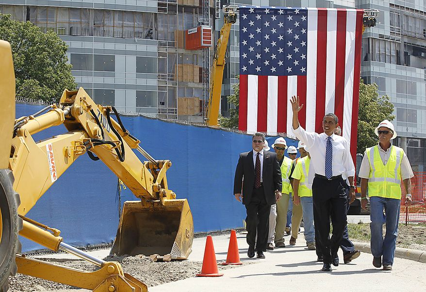 President Obama waves as he tours a Recovery Act highway project in Columbus, Ohio, Friday, June 18, 2010. (AP Photo/Charles Dharapak)