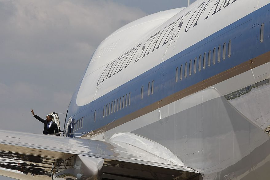 President Obama waves as he boards Air Force One at Port Columbus International Airport in Columbus, Ohio, Friday, June 18, 2010. (AP Photo/Charles Dharapak)