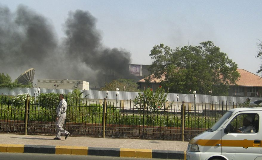 Black smoke is seen coming from the intelligence services building that came under attack in the southern port city of Aden, about 200 miles (320 kilometers) south of the capital, San'a, in Yemen Saturday, June 19, 2010. Four suspected al Qaeda gunmen blasted their way into the intelligence headquarters in Yemen's second largest city Saturday and freed several detainees in the group's most spectacular operation since a U.S.-backed government crackdown began late last year. (AP Photo)