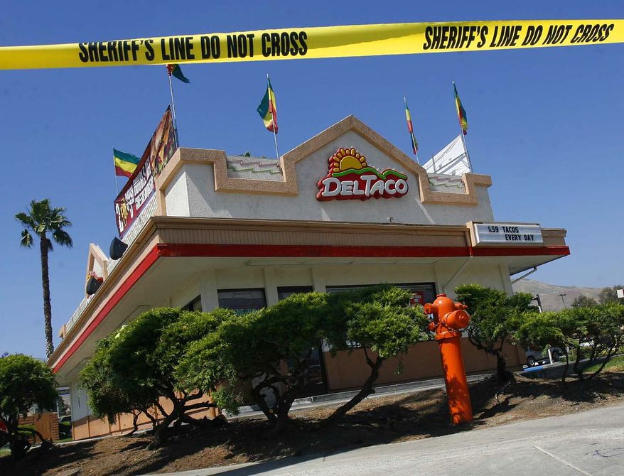 Barrier tape surrounds a Del Taco restaurant in which gunfire erupted on Saturday, June 19, 2010, in San Bernadino, Calif. A man carrying two guns walked into the fast-food restaurant and shot four people who were eating lunch together, killing two -- including a 6-year-old boy -- before turning the gun on himself, police said. (AP Photo/Press-Enterprise, William Wilson Lewis III)