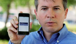 Doug MacGinnitie, a candidate for Georgia secretary of state, shows off his application on an iPhone in Atlanta on Friday. Mr. MacGinnitie had a friend create an iPhone application so supporters can follow his campaign and make contributions. (Associated Press)