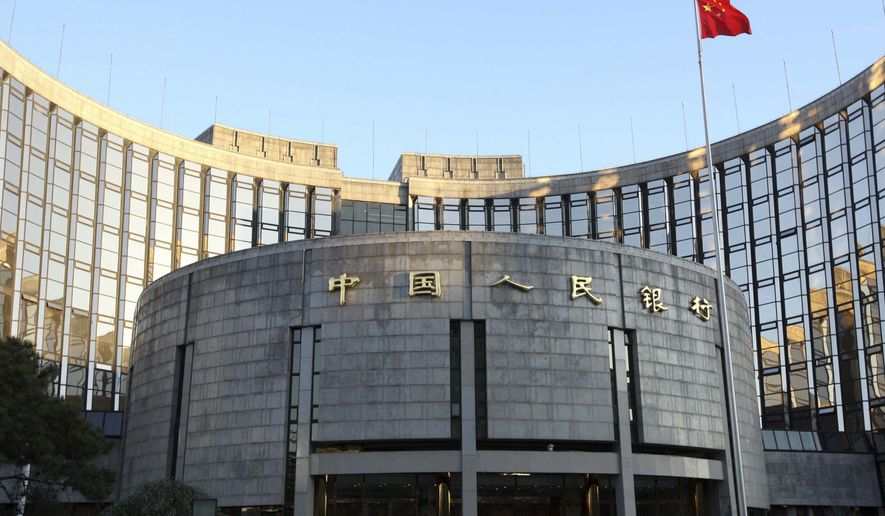"In this Nov. 27, 2008, file photo released by China's Xinhua news agency, a Chinese flag flutters in front of the headquarters of the People's Bank of China in Beijing. China's central bank said Sunday June 20, 2010, it would maintain a stable exchange rate and didn't anticipate major changes in the value of the yuan, a day after saying it would manage the currency more flexibly. In a commentary on Saturday's announcement, the People's Bank of China attempted to assuage fears of a major strengthening of the yuan, also known as the renminbi, or ""people's money."" (AP Photo/Xinhua, Gao Xueyu, File)"