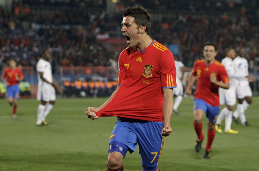 ASSOCIATED PRESS Spain's  David Villa, center, celebrates after scoring a goal during the World Cup group H soccer match between Spain and Honduras at Ellis Park Stadium in Johannesburg, South Africa, Monday, June 21, 2010. Spain won 2-0.