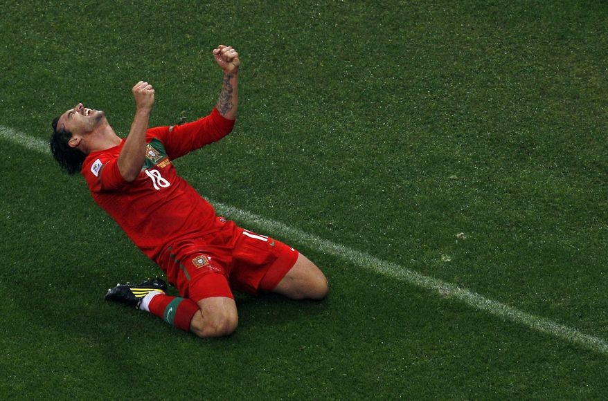 Portugal's Hugo Almeida celebrates after scoring the team's third goal during the World Cup Group G soccer match between Portugal and North Korea in Cape Town, South Africa, Monday on June 21, 2010. (AP Photo/Roberto Candia)
