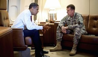 COVER OF THE ROLLING STONE: President Obama meets with Gen. Stanley A. McChrystal, the top commander in Afghanistan, aboard Air Force One in Copenhagen in October. Their Wednesday meeting will focus on comments the general made to Rolling Stone magazine. (Associated Press)