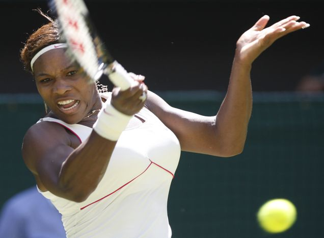 Defending champion Serena Williams returns to Michelle Larcher De Brito of Portugal, during their women's singles, first round match on the Centre Court at the All England Lawn Tennis Championships at Wimbledon, Tuesday, June 22, 2010. (AP Photo/Sang Tan)