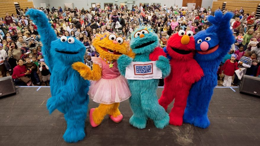 """Sesame Street"" characters (from the left) Cookie Monster, Zoe, Rosita, Elmo and Grover are touring 40 U.S. military bases to entertain and offer advice to children with deployed parents. The tour is a joint project of the USO and Sesame Workshop. (Photograph provided by USO)"