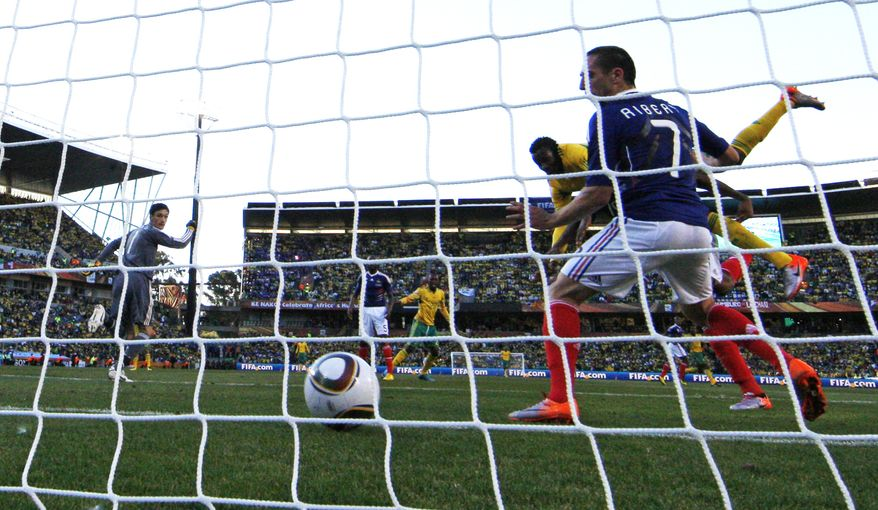 ASSOCIATED PRESS South Africa's Bongani Khumalo, back right, scores a goal past France goalkeeper Hugo Lloris, left, and France's Franck Ribery, front right, during the World Cup group A soccer match between France and South Africa at Free State Stadium in Bloemfontein, South Africa, on Tuesday June 22, 2010.