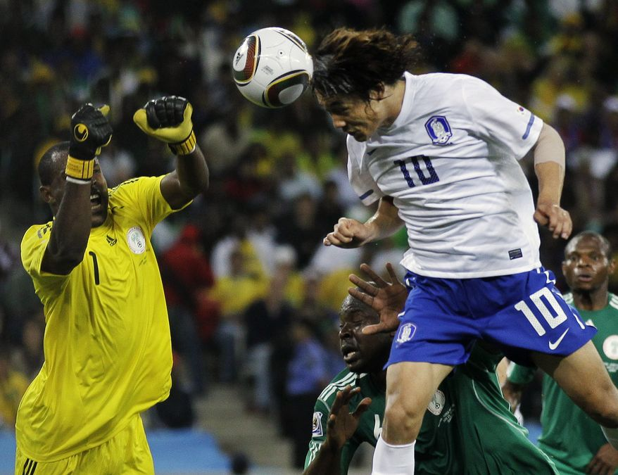 ASSOCIATED PRESS South Korea's Park Chu-young, right, tries to score a goal as Nigeria goalkeeper Vincent Enyeama, left, prepares to punch it away during the World Cup group B soccer match between Nigeria and South Korea at the stadium in Durban, South Africa, Tuesday, June 22, 2010.