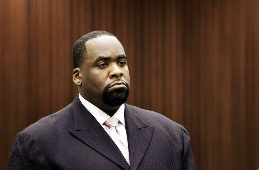 Former Detroit Mayor Kwame Kilpatrick listens to a judge sentence him in May for probation violations. Kilpatrick was indicted on federal fraud and tax charges Wednesday. He is accused of using his tax-exempt charity, the Kirkpatrick Civic Fund, as a slush fund for personal expenses. (Associated Press)