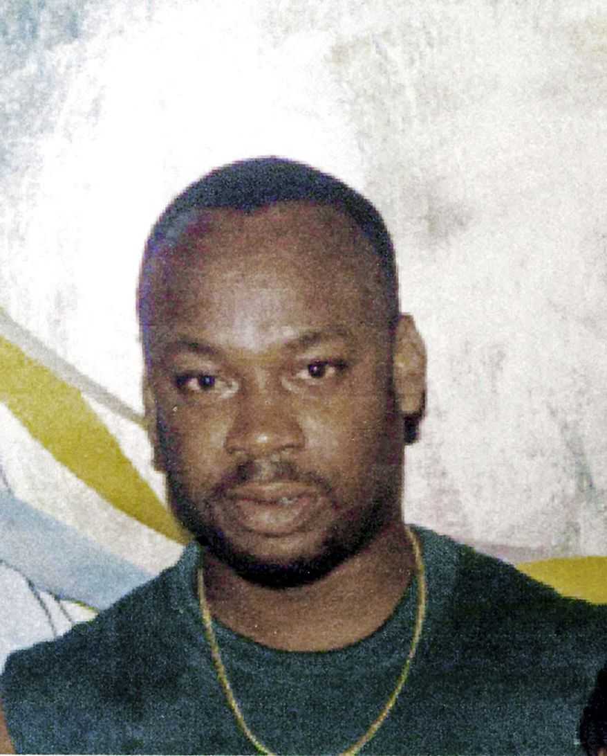 "Purported drug gang leader Christopher ""Dudus"" Coke, who eluded a bloody police offensive in his slum stronghold last month, surrendered to authorities outside Jamaica's capital Tuesday, June 22, 2010, local news media reported. (AP Photo/The Jamaica Gleaner) JAMAICA OUT"