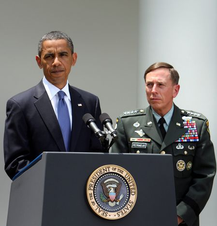 President Barack Obama speaks about the resignation of Gen. Stanley A. McChrystal, the commander of U.S. troops in Afghanistan, at the White House as Gen. David H. Petraeus listens. Mr. Obama said Gen. Petraeus, previously the commander of U.S. forces in the Middle East and Central Asia, will replace Gen. McChrystal. (Bloomberg)