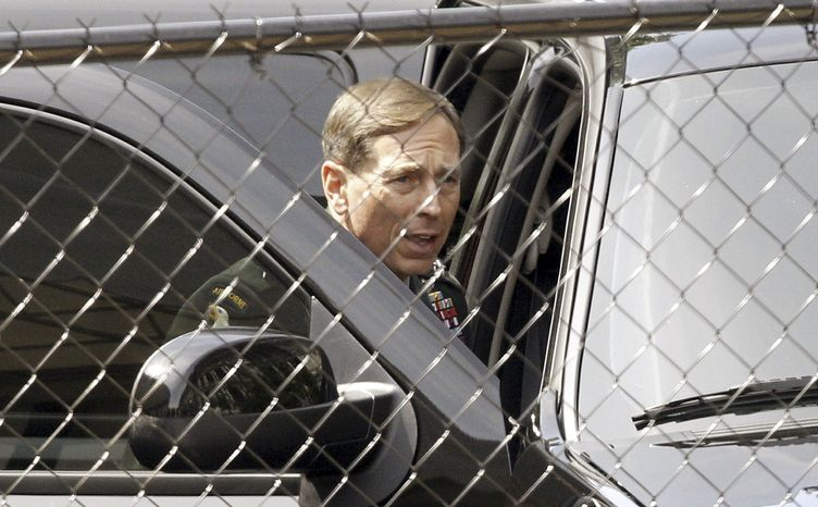 Gen. David Petraeus, who leads the U.S. Central Command, arrives at the White House in Washington on Wednesday, June 23, 2010, before the start of the national security team meeting on Afghanistan and Pakistan in the Situation Room. (AP Photo/Evan Vucci)