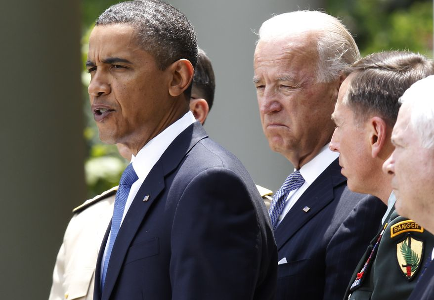 President Barack Obama stands with (from second from left) Joint Chiefs Chairman Adm. Mike Mullen, Vice President Joe Biden, Gen. David Petraeus, and Defense Secretary Robert Gates, in the Rose Garden of the White House on Wednesday to announce that Petraeus would replace Gen. Stanley McChrystal. (Associated Press)